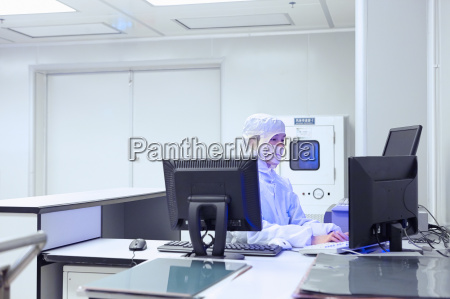 female factory worker using computer in