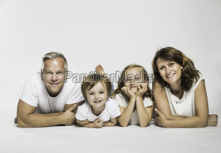 studio portrait of parents lying on