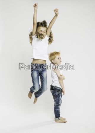studio portrait of boy standing and