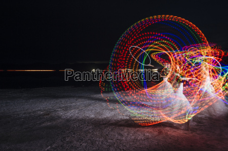 woman dancing with illuminated multi coloured