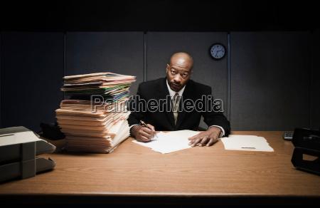 business man at desk doing paperwork