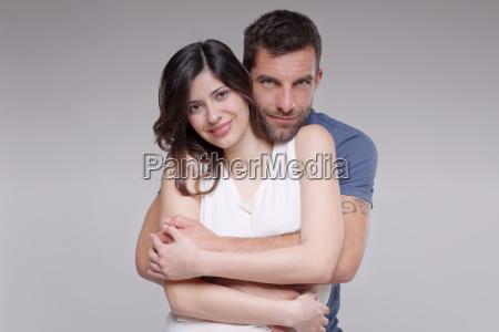 portrait of heterosexual couple hugging