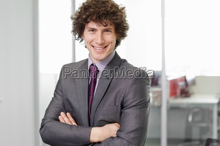 portrait of businessman with curly hair