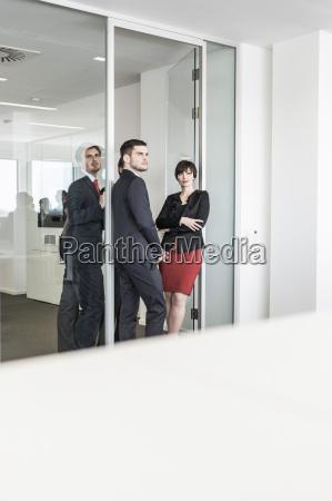 businesspeople standing in doorway