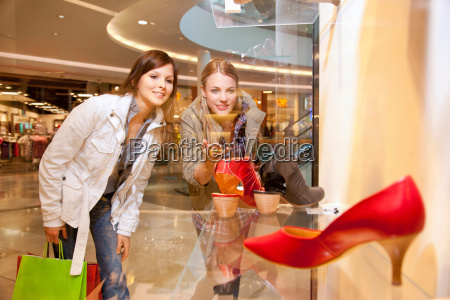 girls checking out shoes in a
