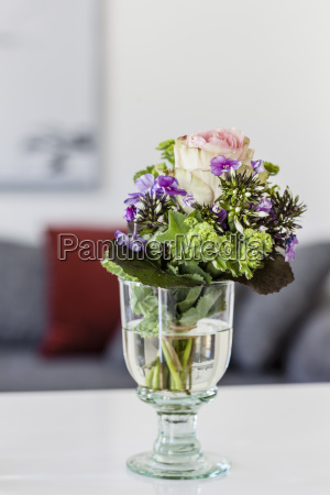 wine glass with cut flowers on