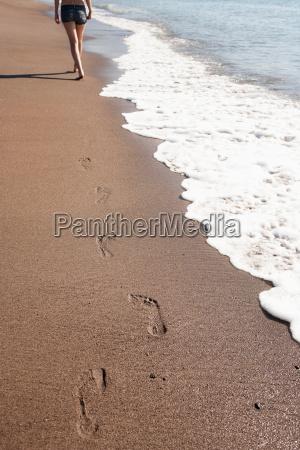 womans footprints on beach