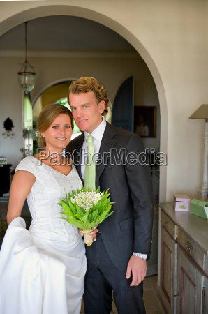 bride and groom portrait in house