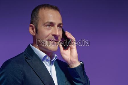 mature man using smartphone