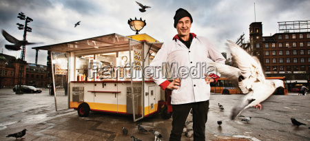 smiling man standing outside food truck