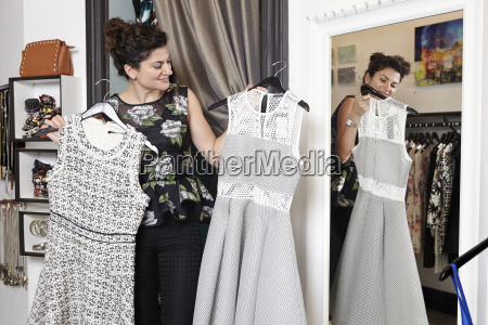 mature woman in fashion boutique holding