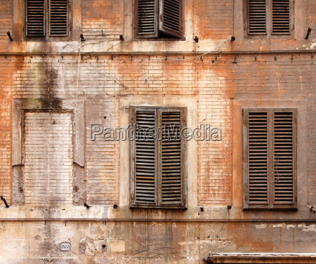 wooden shutters on abandoned building