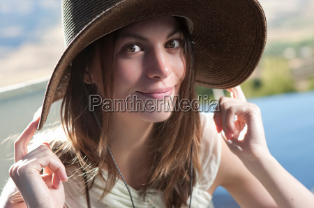 smiling woman wearing hat outdoors