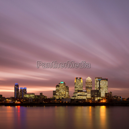 urban skyline lit up at night