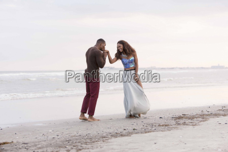 couple on beach man kissing womans