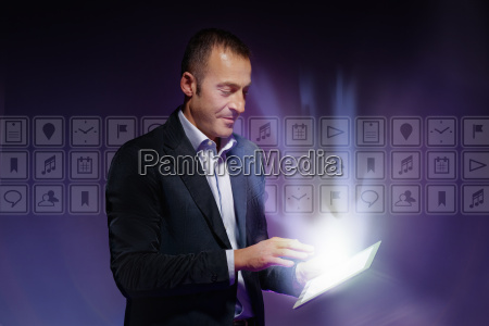 man using digital tablet light illuminating