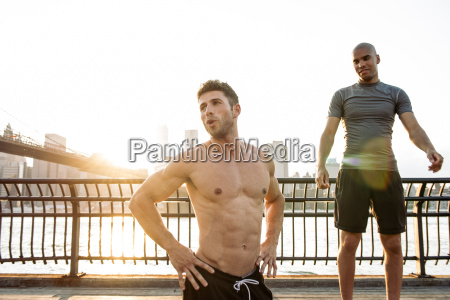 two young male friends training on