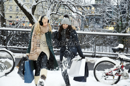 two mid adult women in snow