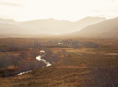 view of winding river and mountains