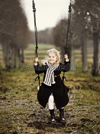 girl on swing in countryside copenhagen