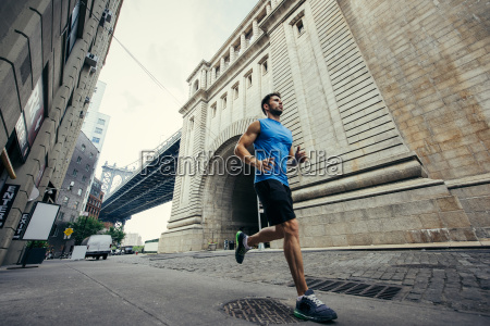 young male runner running in brooklyn