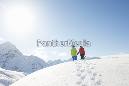 couple walking in snow kuhtai austria