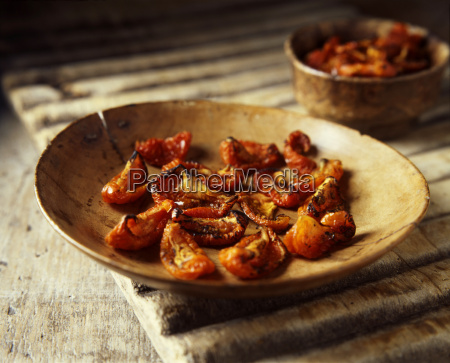 sun blushed tomatoes in wooden bowl