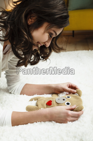woman looking at babys soft toy