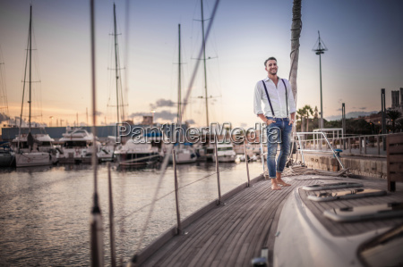 young man relaxing on yacht cagliari