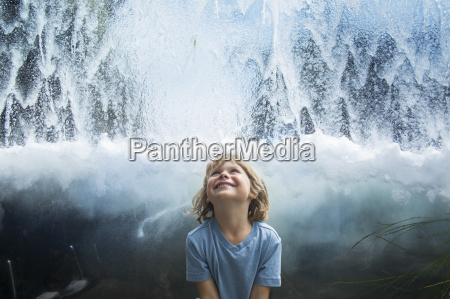 young boy looking up at flowing