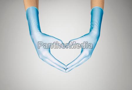 gloved hands making heart shape
