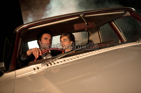 couple driving together at night