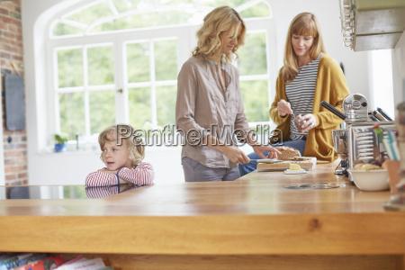 two mid adult women preparing food