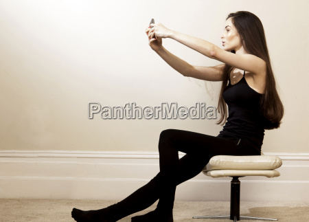 side view of young woman sitting