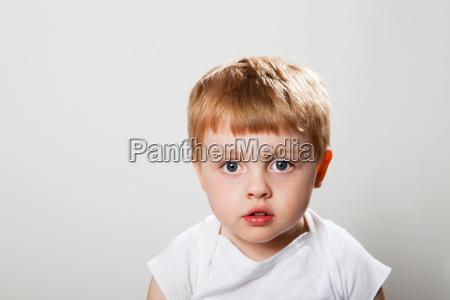 pensive looking boy