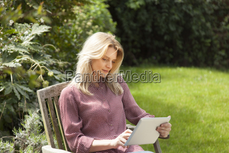 mid adult woman in garden chair