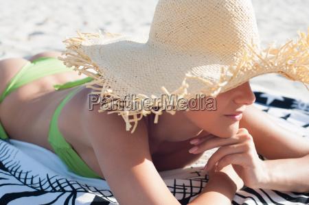 woman wearing straw hat on beach