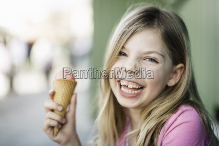 portrait of young girl eating icecream