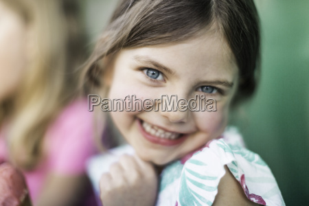 young girl smiling at the camera