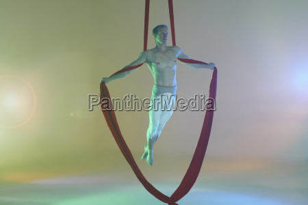 aerial dancer with red ribbon