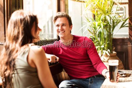 couple sitting together smiling enjoying a