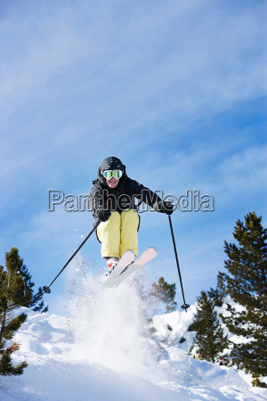 male skier mid air on mountainside