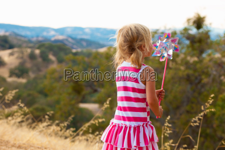 girl blowing pinwheel mt diablo state