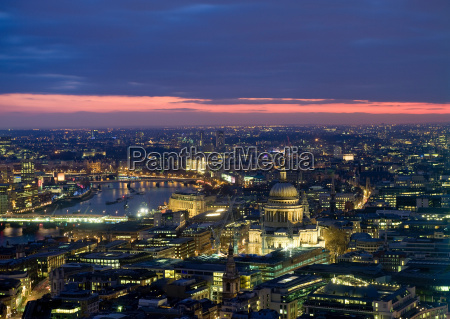 aerial view of cityscape lit up