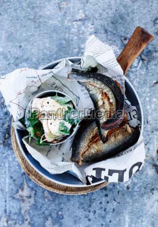 bowl of smoked fish with salad