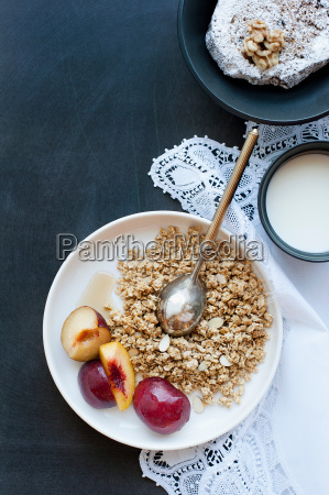 plate of oatmeal with fruit and