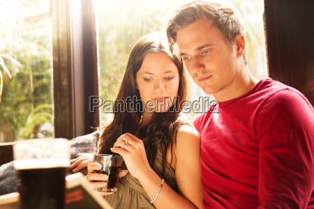 couple sitting having a drink together
