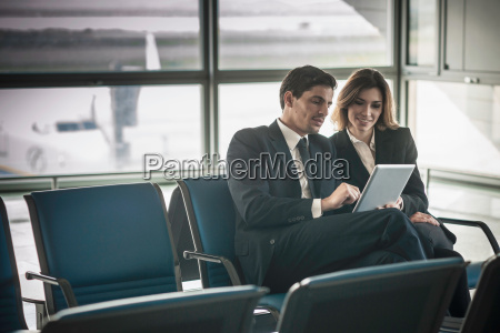 businesspeople using digital tablet in airport