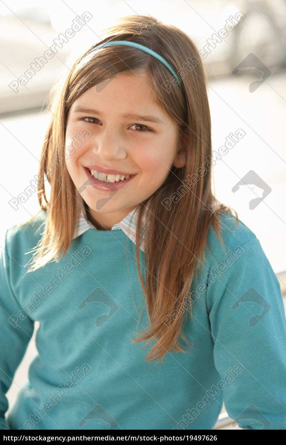 close, up, of, girl's, smiling, face - 19497626