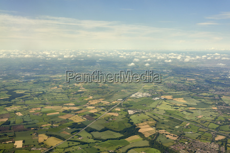 aerial view of fields and cloudscape